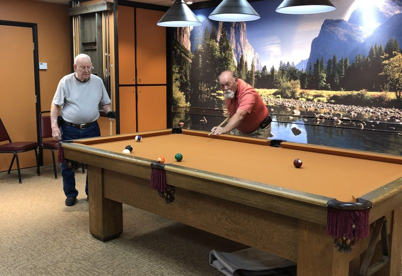 Playing pool in the Game Room